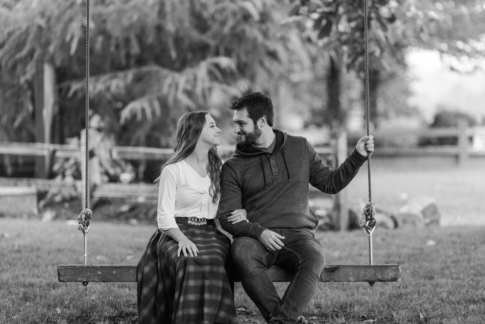 romantic photos of engaged couple of tree swing for engagement photos in Snohomish, WA near Seattle