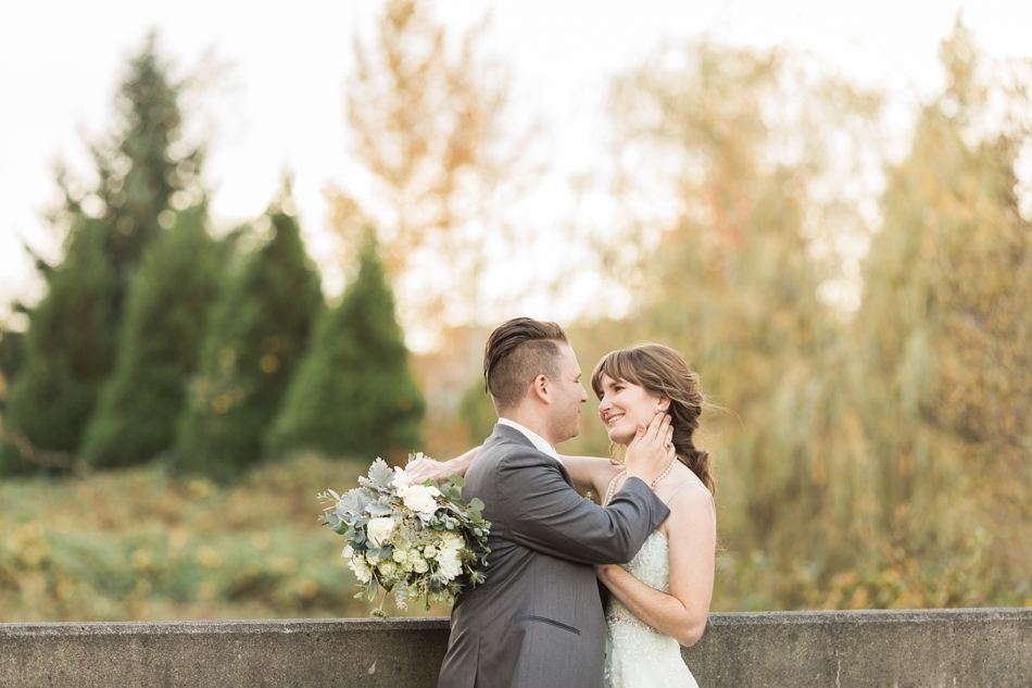 A bride and groom look lovingly into each other's eyes before their fall wedding at the Loft at Russell's in Bothell, a wedding venue near Seattle. | Joanna Monger Photography | Snohomish & Seattle Wedding Photographer
