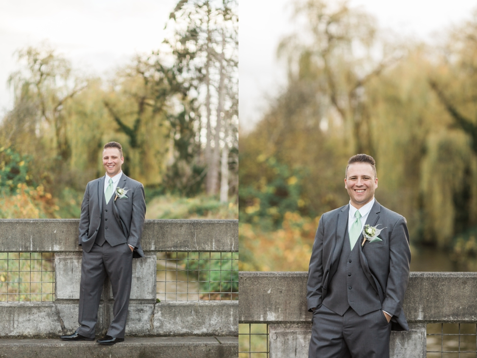 A groom smiles while standing on a concrete bridge before his fall wedding at the Loft at Russell's in Bothell, a wedding venue near Seattle. | Joanna Monger Photography | Snohomish & Seattle Wedding Photographer