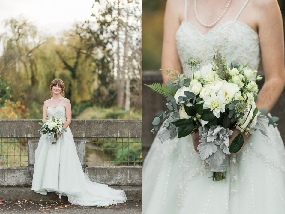 A bride smiles while holding her bouquet while standing on a concrete bridge before her fall wedding at the Loft at Russell's in Bothell, a wedding venue near Seattle. | Joanna Monger Photography | Snohomish & Seattle Wedding Photographer