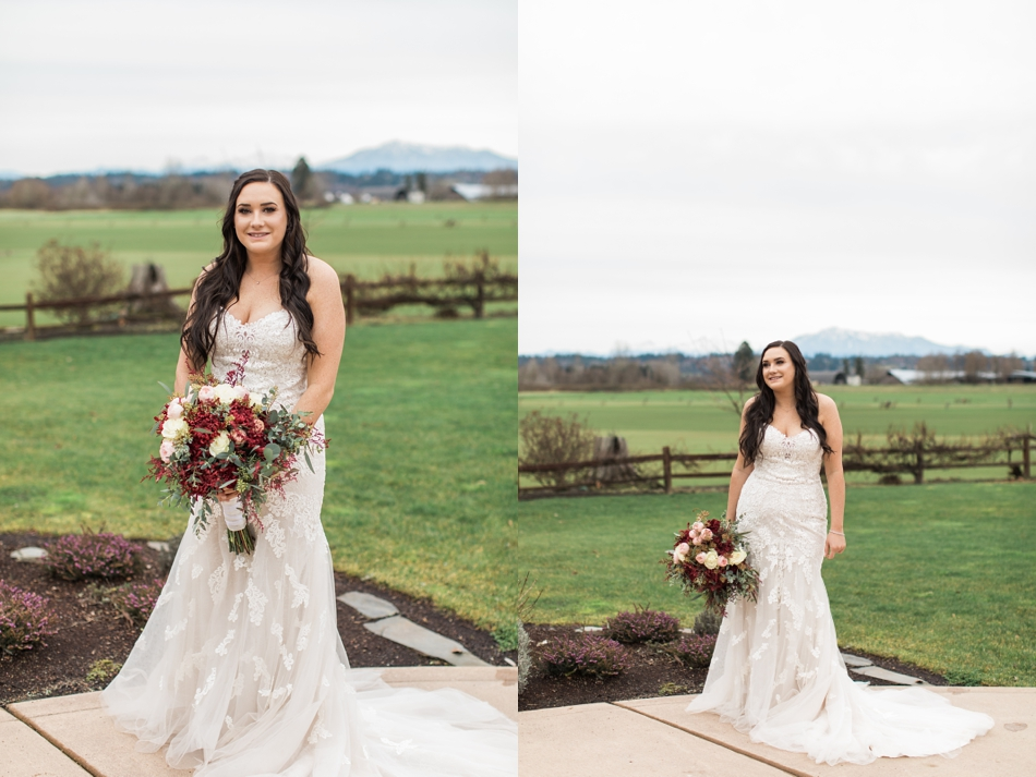 A photo of a bride standing outside near a field and mountains before a winter wedding at Hidden Meadows in Snohomish, a wedding venue near Seattle, WA. | Joanna Monger Photography | Snohomish & Seattle Wedding Photographer