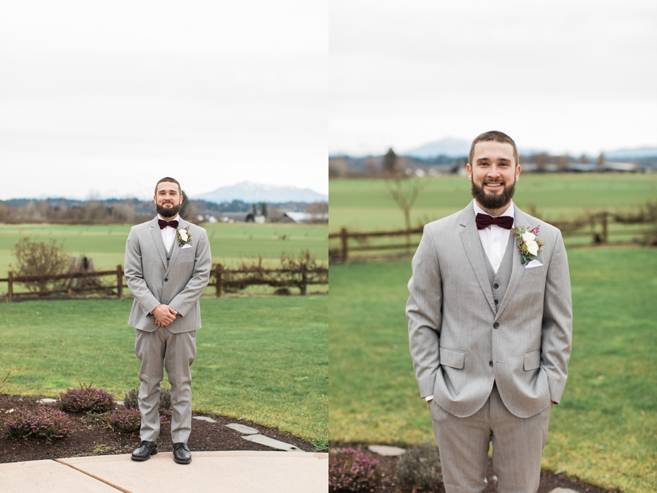 A photo of a groom standing outside in front of a field and mountains before his winter wedding at Hidden Meadows in Snohomish, a wedding venue near Seattle, WA. | Joanna Monger Photography | Snohomish & Seattle Wedding Photographer