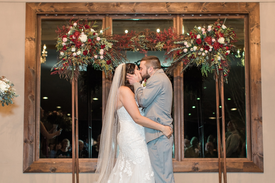 A photo of a bride and groom kissing at the altar during their winter wedding at Hidden Meadows in Snohomish, a wedding venue near Seattle, WA. | Joanna Monger Photography | Snohomish & Seattle Wedding Photographer