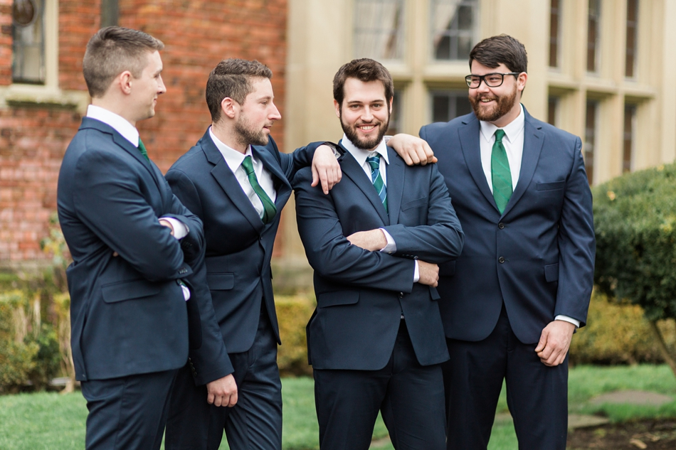 A groom stands outside with his groomsmen before his regal winter wedding at Thornewood Castle in Lakewood, a wedding venue near Seattle, WA. | Joanna Monger Photography | Seattle & Snohomish Wedding Photographer