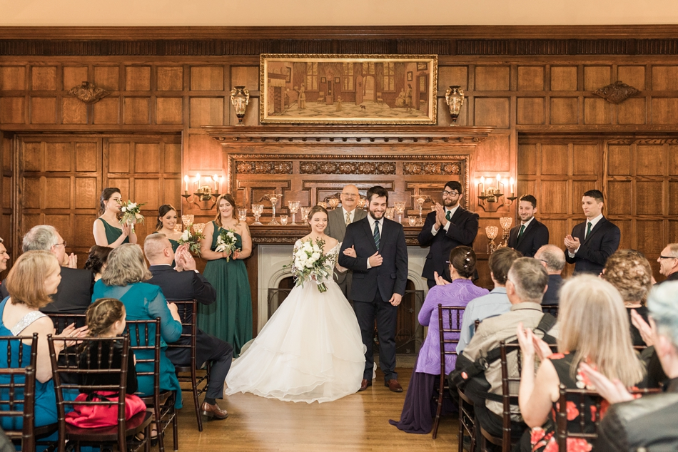 A bride and groom walk down the aisle after the ceremony from a regal winter wedding at Thornewood Castle in Lakewood, a wedding venue near Seattle, WA. | Joanna Monger Photography | Seattle & Snohomish Wedding Photographer