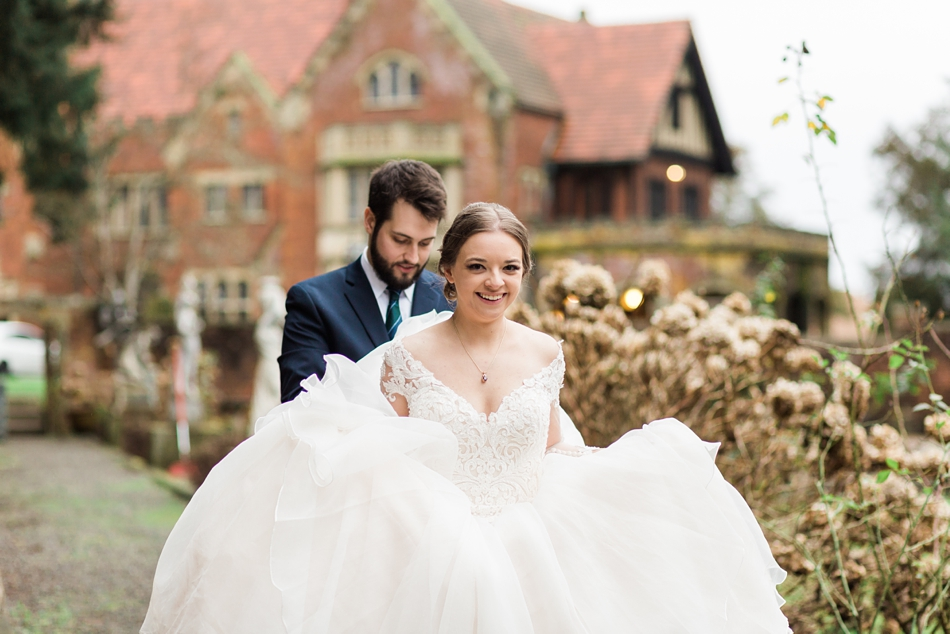 A photo of a bride and groom after their regal winter wedding at Thornewood Castle in Lakewood, a wedding venue near Seattle, WA. | Joanna Monger Photography | Seattle & Snohomish Wedding Photographer