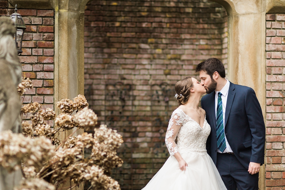 A bride and groom kiss after their regal winter wedding at Thornewood Castle in Lakewood, a wedding venue near Seattle, WA. | Joanna Monger Photography | Seattle & Snohomish Wedding Photographer