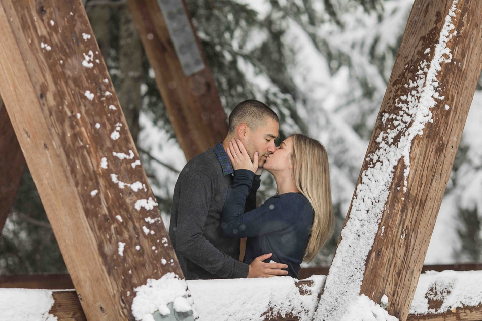 During their outdoor winter snow engagement photography session, a couple kisses. | Joanna Monger Photography | Snohomish Wedding Photographer