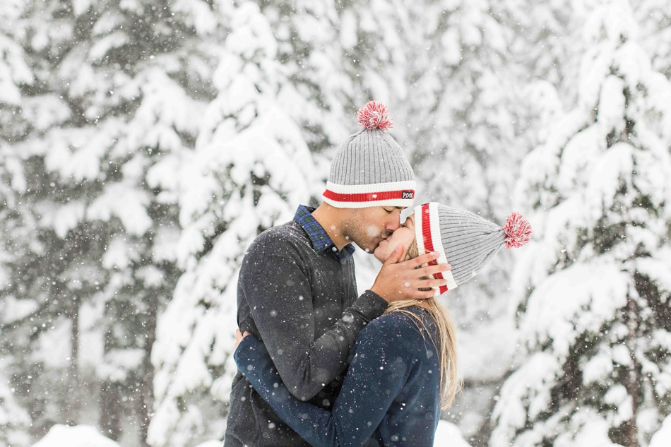 An engaged couple kisses during their outdoor winter snowy engagement photo shoot. | Joanna Monger Photography | Snohomish Wedding Photographer