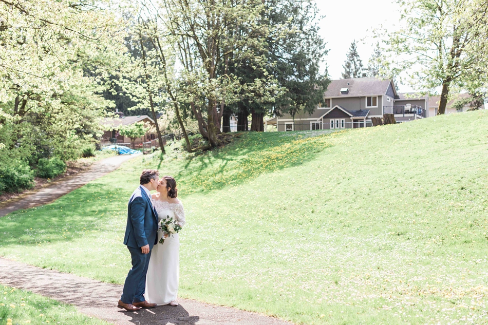 An couple kisses before their intimate wedding at Belle Chapel in Snohomish, a wedding venue near Seattle, WA. | Joanna Monger Photography | Snohomish Wedding Photographer