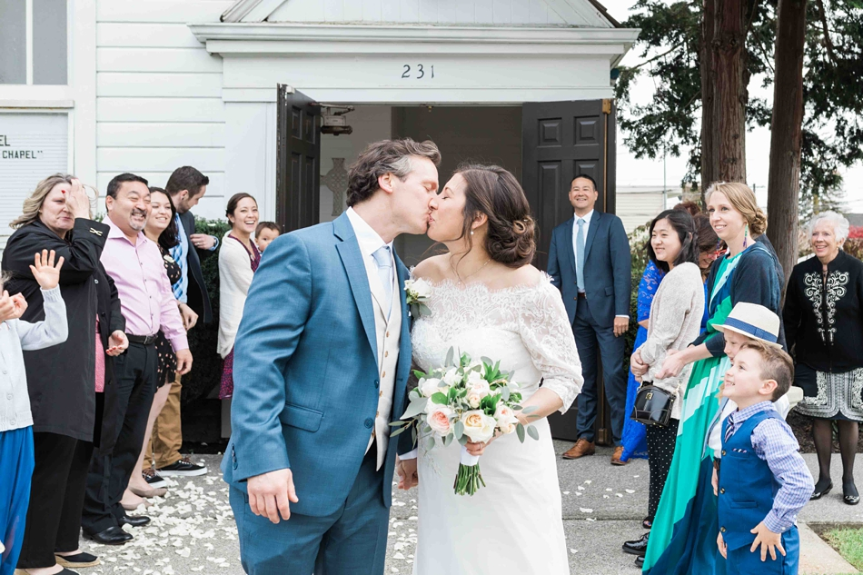 A bride and groom kiss after their intimate wedding at Belle Chapel in Snohomish, a wedding venue near Seattle, WA. | Joanna Monger Photography | Snohomish Wedding Photographer