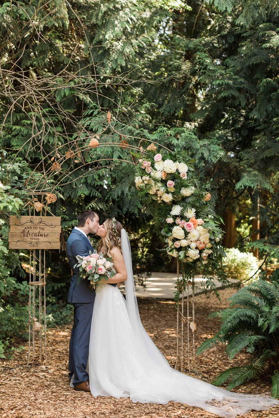 Kissing in the forest at Twin Willow Gardens in Snohomish. Photos by Joanna Monger Photography, Snohomish and Seattle Wedding Photographer.