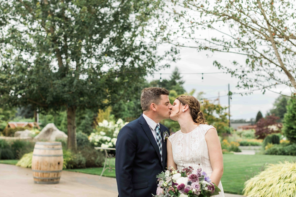 A pre-wedding kiss at Pine Creek Nursery in Monroe. Photos by Joanna Monger Photography, Snohomish and Woodinville Wedding Photographer.