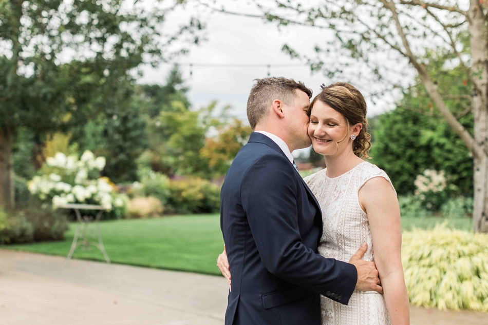 Making the bride smile at Pine Creek Nursery in Monroe. Photos by Joanna Monger Photography, Snohomish and Woodinville Wedding Photographer.