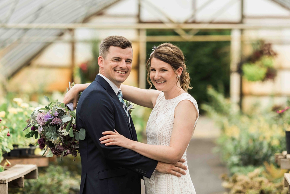 The happy couple at Pine Creek Nursery in Monroe. Photographs by Joanna Monger Photography, Snohomish's Best Wedding Photographer.