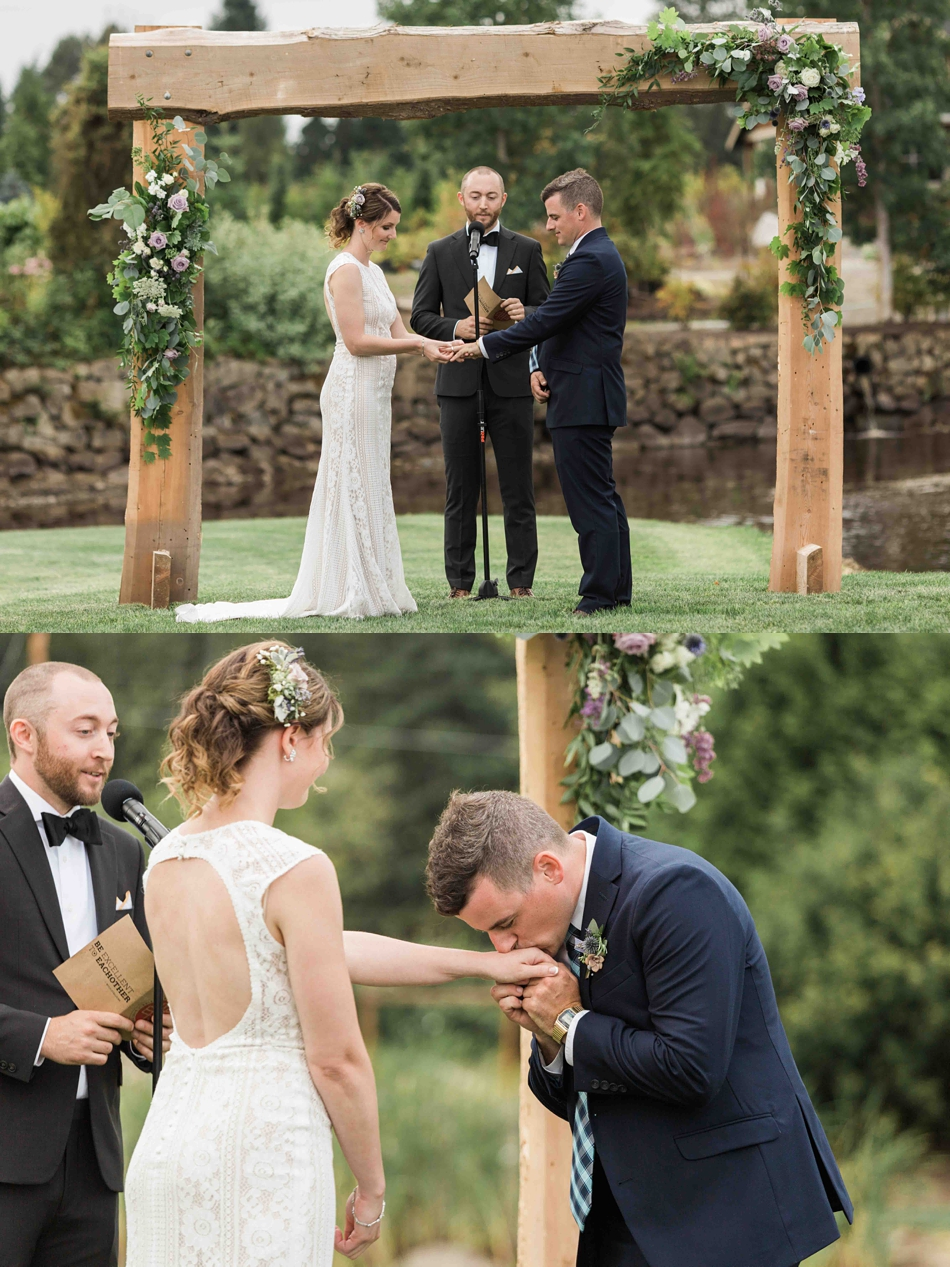 The groom kisses the brides hand at Pine Creek Nursery in Monroe. Photos by Joanna Monger Photography, Snohomish and Seattle Wedding Photographer.