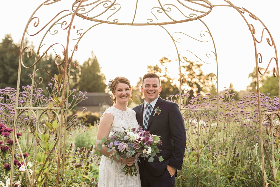 Happy under a trellis at Pine Creek Nursery in Monroe. Photos by Joanna Monger Photography, Snohomish and Seattle Wedding Photographer.