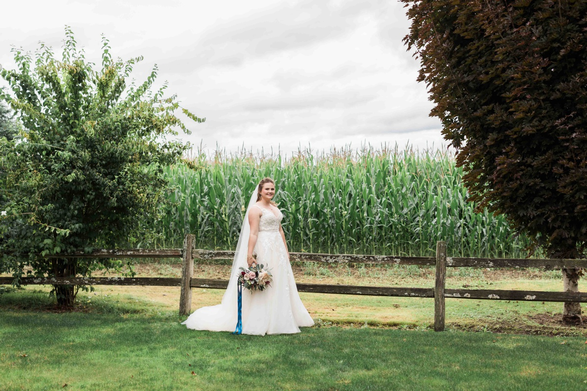 Bride holding flowers at Craven Farms in Snohomish. Photographs by Joanna Monger Photography, Snohomish's Best Wedding Photographer.