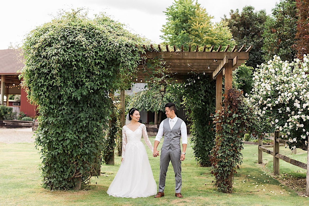 Holding hands on their special day at Craven Farms in Snohomish. Photos by Joanna Monger Photography, Snohomish and Woodinville Wedding Photographer.