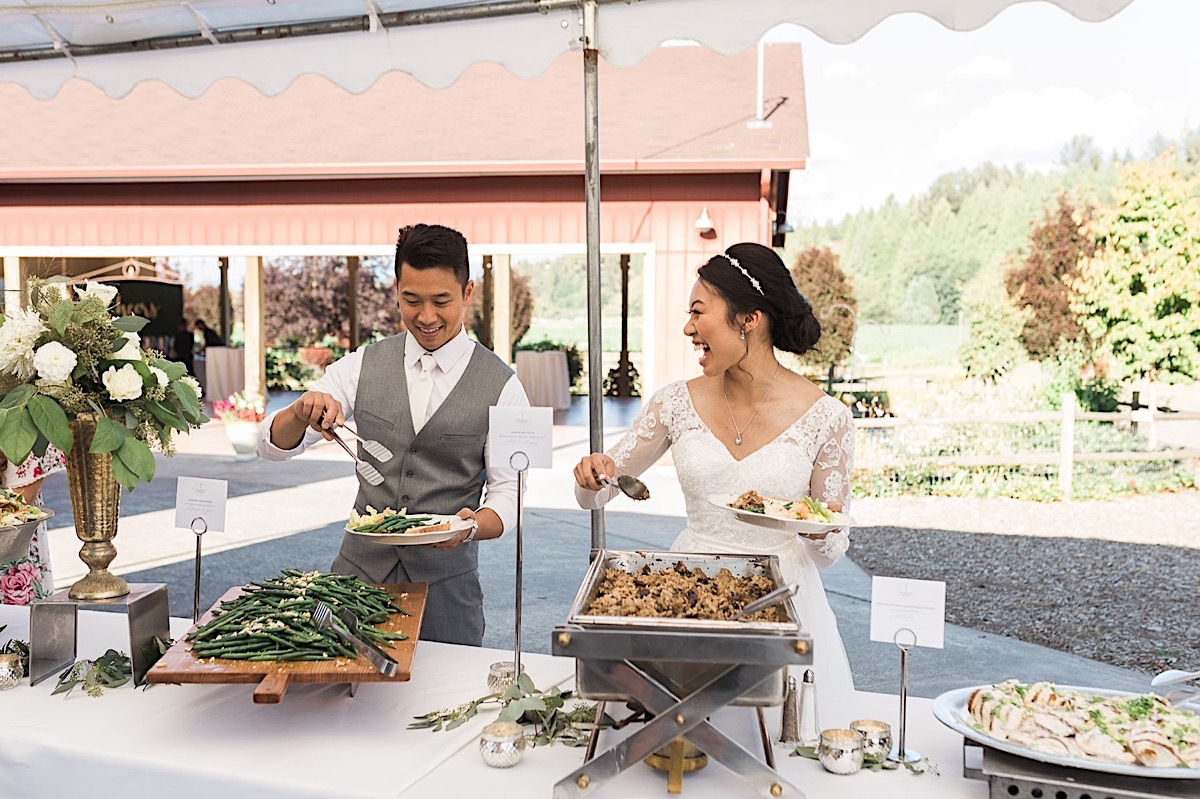 Serving the meal at Craven Farms in Snohomish. Photos by Joanna Monger Photography, Snohomish and Seattle Wedding Photographer.