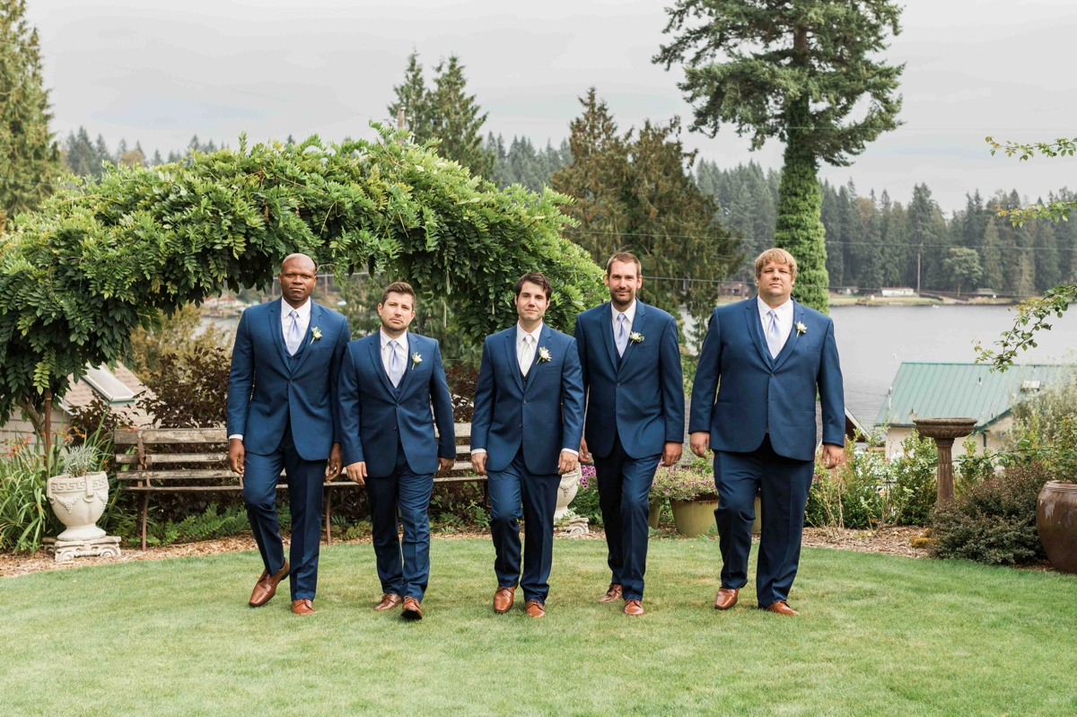 Groomsmen walking together at Green Gates at Flowing Lake. Photos by Joanna Monger Photography, Snohomish and Seattle Wedding Photographer.