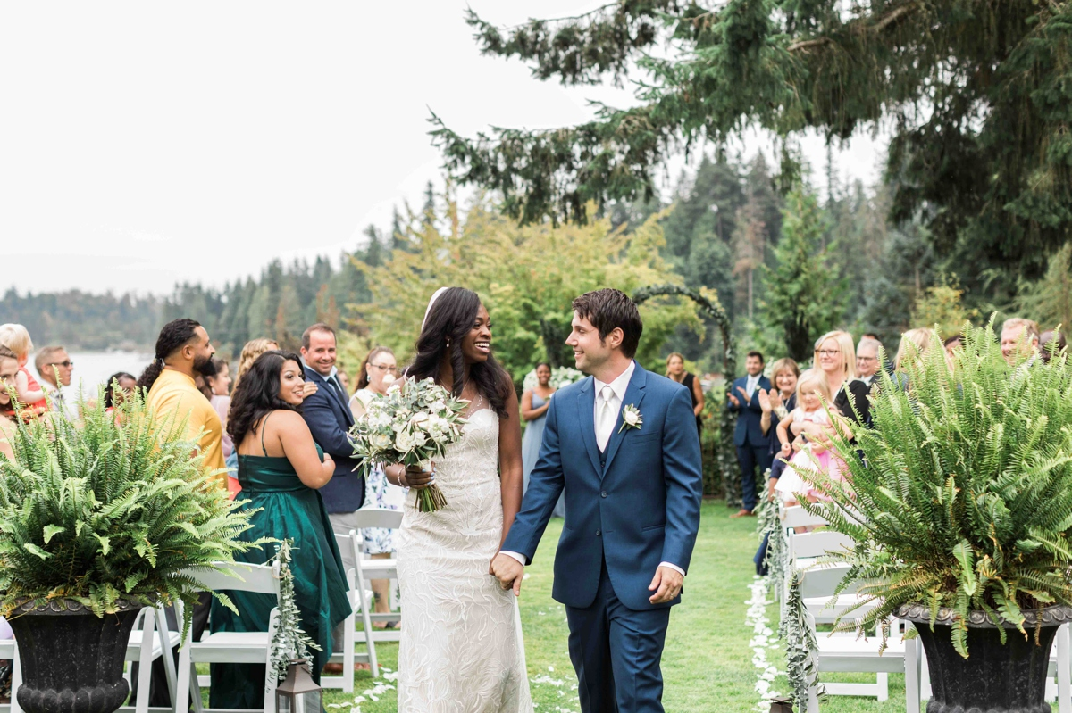 Bride and groom walking down the aisle at Green Gates at Flowing Lake. Photographs by Joanna Monger Photography, Snohomish's Best Wedding Photographer.