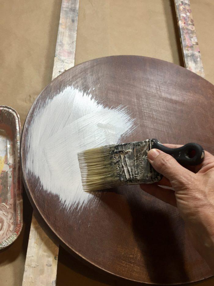 priming table top before acrylic paint pour.