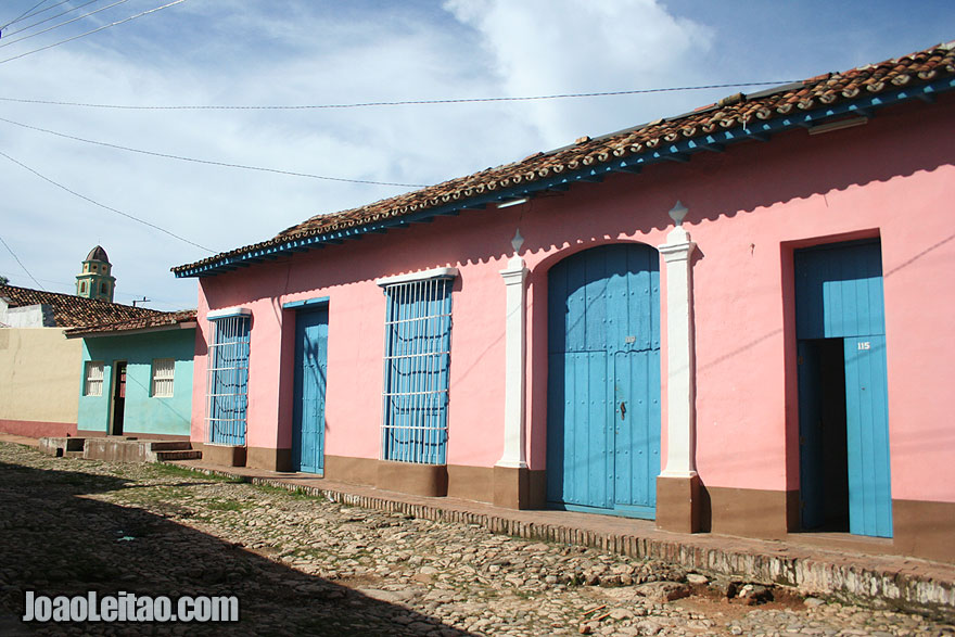 Pink building with blue doors and windows in Trinidad