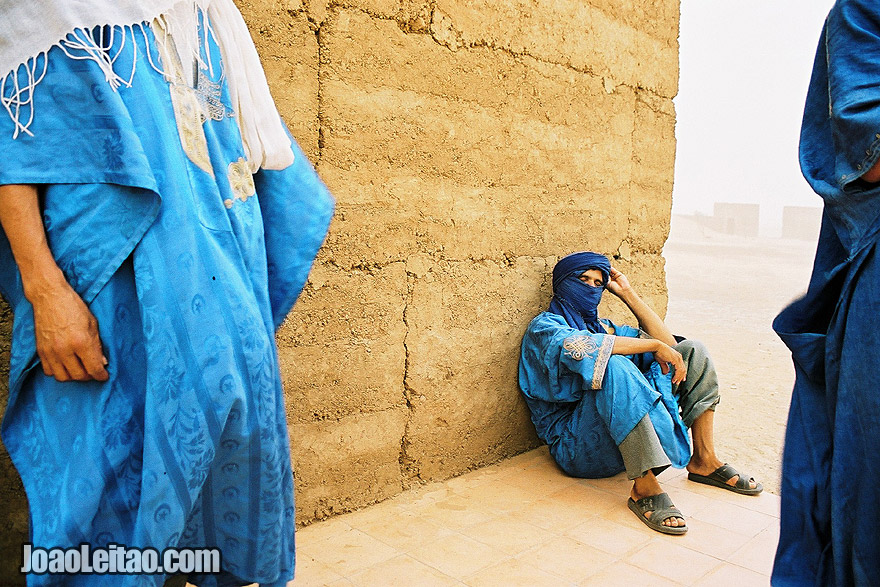 Photo of the Blue Men of Morocco during a sand storm in Sahara Desert, Morocco