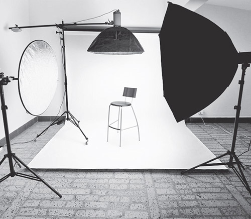 A picture containing wall, umbrella, indoor, chair  Description automatically generated