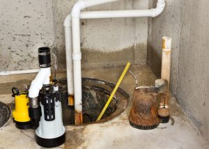sump pump inspection with tools in house