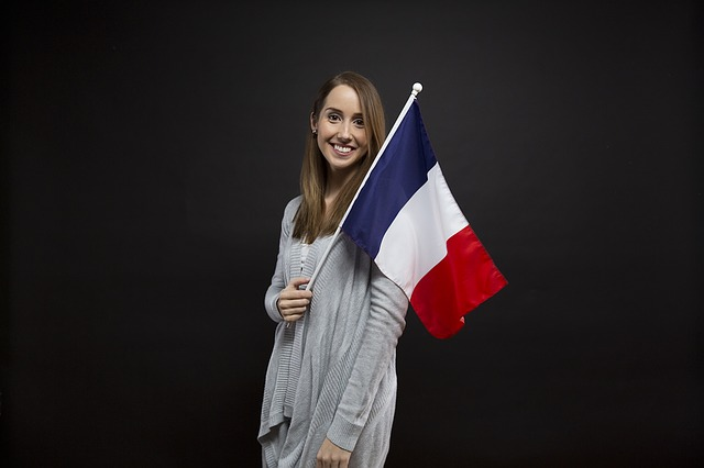 French student get job in france and have flag in hand