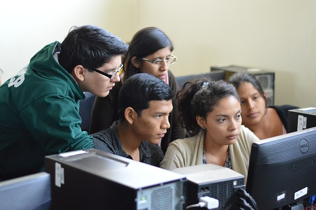 Student Group watching computer for career information.