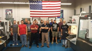 Caption: Machining instructors Dwight Barnes and Dexter Edwards are pictured with first and second year machining students.