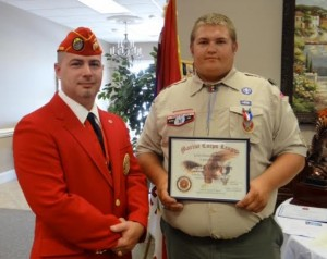 Dakota Thompson (far right) was awarded the rank of Eagle Scout on Sunday. He also received the Good Citizenship Award from Lewis Rice III (left), Eagle Scout Coordinator for the Johnston County Marine Corps League Carry-On Detachment.