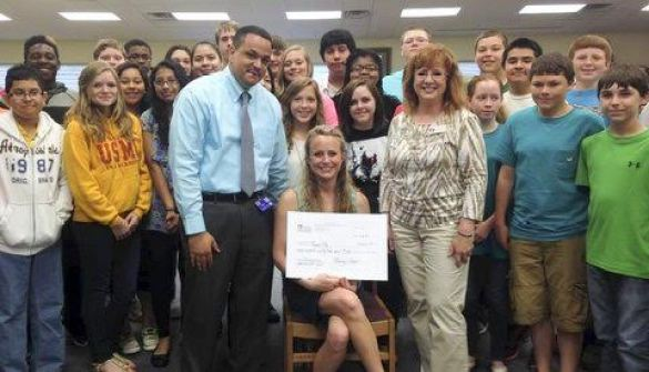 On the front row (from left) on May 21, are Principal Ron Anthony, grant recipient Magen Pike, and Johnston County Education Foundation Representative Judy Boyette. On the middle row are Eric Macias, Emmy Poole, Daphine Argandona, Heidi Perez, Gabby Godwin, Kandice Adams, Shaina Simmons, Hannah Ginn, Bryanna Konig, Hank Williams, and Marshall Blackman. On the back row are Hezikiah Bailey, Luke Wood, Christopher Surles, Tommi Butts, Estaphanie Gamez, Brandon Lushene, Maricela Chavez, Matthew Valentino, Alexander Marler, Noah Higgins, Aubry Pollard, Juan Pavon, and Austin Williams.