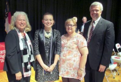Cleveland High School senior Marina Roe (right-center) is a 2015 Joyce W. Wade Scholarship recipient. Standing with her (from left) are Joyce Wade, Kimberly Roe, and Principal Anne Meredith.