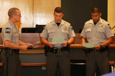 Police Chief R.W. Bridges welcomes Officers Daniel Evans and Erick Martinez to the Clayton Police force.