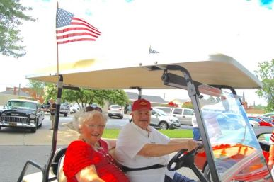 Even the golf carts were patriotic on Saturday in Benson for the town's 15th annual Independence Day celebration. In the photo, Billy and Linda Massengill, parents of Benson Mayor William Massengill, pull up to the Singing Grove with a couple of flags flying.