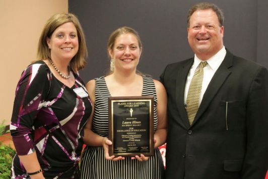 Corinth-Holders Elementary's Laura Hines (center) is the 2016 Flame for Learning Award winner. Standing with her (from left) are Corinth-Holders Elementary Principal Melissa Hubbard and JCS Superintendent Dr. Ross Renfrow.