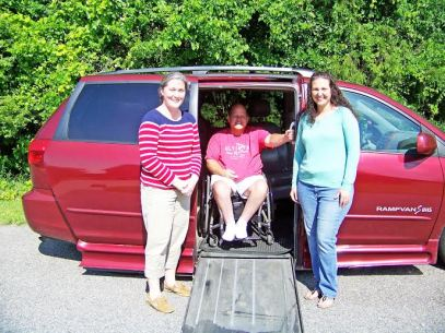 David Anderson (center) of Pine Level is in need of a new wheelchair van.  His wife, Carmen, (right) works with Danielle Haddock of Princeton (left) who entered David in a nationwide contest to win a new van. Residents can vote once a day online, now through May 31st, to help David win a van. JoCoReport.com Photo
