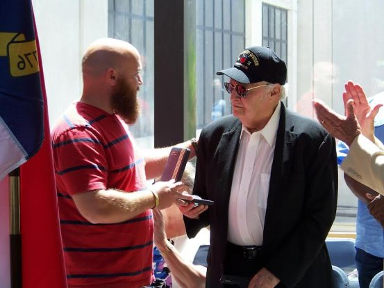(Right to Left) Edward M. Kirks, one of 4 brothers from Selma to fight in World War II, is surprised by his grandson, Army veteran Travis Kirks, during the Memorial Day Ceremony at the Johnston County Courthouse. Travis drove in from Texas to present his grandfather with 3 World War II medals he should have received in 1945. JoCoReport.com Photo