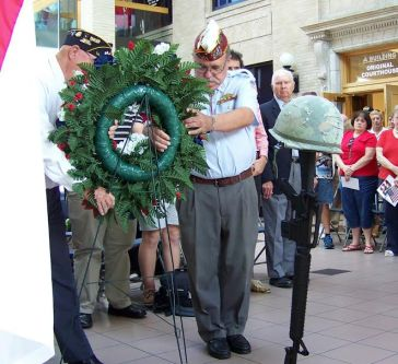 Veterans lay a wreath in honor of those who died protecting our country.  JoCoReport.com Photo