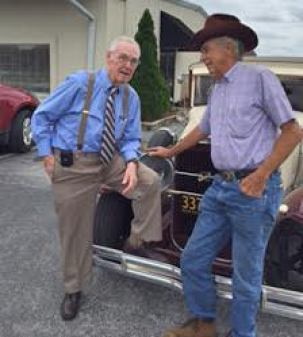 WTSB's Carl Lamm (left) poses with Lizard Lick Mayor Woody Wood in front of Wood's 1931 Buick.