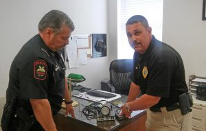 Four Oaks Police Chief Stephen Anderson examines a radar unit with Officer B.L. Flowers. The used radar unit was loaned to Four Oaks Police this week from the Princeton Police Department but because no Four Oaks officers are certified to use the unit, the department cannot issue speeding tickets based on the radar readings. JoCoReport.com Photo