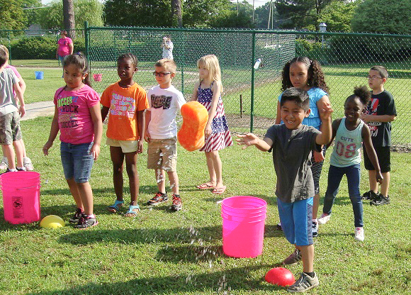 Pictured waiting for their turn at the Sponge Toss game from Laura Hansen's first grade class are (from left) Ingrid Martinez-Franco, Conita Thomas, Devan Pace, Reace Soronen, Yair Barrios (shown tossing the sponge), Karla Lorenzo, Nasiyaah Barnes and Darey Rivera.