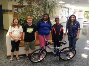 Students who won new bicycles for showing growth and proficiency on their end of grade tests this month (from left) are Shyann Spencer, Luke Woodall, Janashia O'Neal, Deion Wright, Karelli Bojorquez-Armenta. Bicycle winners who are not pictures are Julius Jones, Jade Hernandez Navarro, Sergio Parejo, and Michell Terran-Herrara.