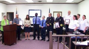 Selma Mayor Cheryl Oliver (left) recognizes officials from Sysco, the Selma Fire Department and Selma EMS whose combined efforts saved the life of Sysco employee and Archer Lodge fireman John Dusek on May 20th.  JoCoReport.com Photo