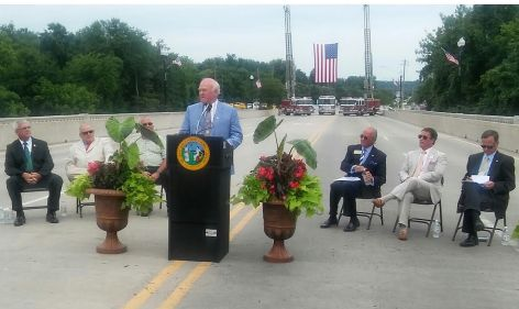 Former Johnston County Sheriff Freddy Narron fondly remembers Deputy Paul West during a bridge dedication ceremony Friday for the fallen officer.