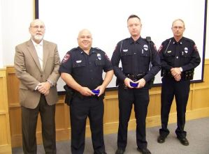 (left to right) Mayor Pro Tem Emery Ashley, Lt. Ryan Sheppard, Officer Sean Cook, and Interim Police Chief Keith Powell at Tuesday night's Smithfield Town Council meeting. JoCoReport.com Photo